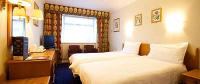 Apollo Hotel - Garden View Bedroom
